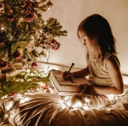 photo-of-girl-sitting-near-christmas-tree-3303613.jpg